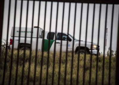 fence and border patrol truck